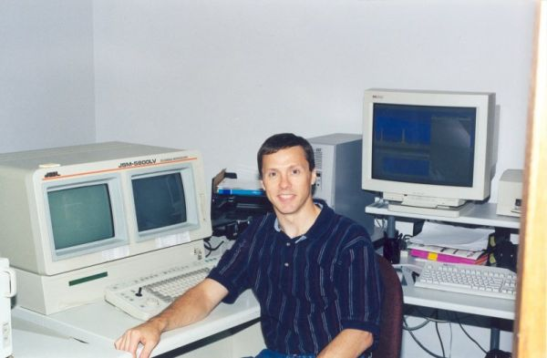Larry Hanke with MEE's first Scanning Electron Microscope, 1995